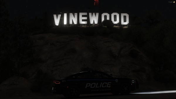 Vinewood Charger by the iconic Vinewood sign